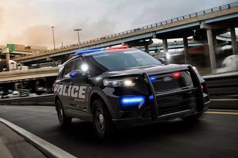 Ford police interceptor utility drives on the highway